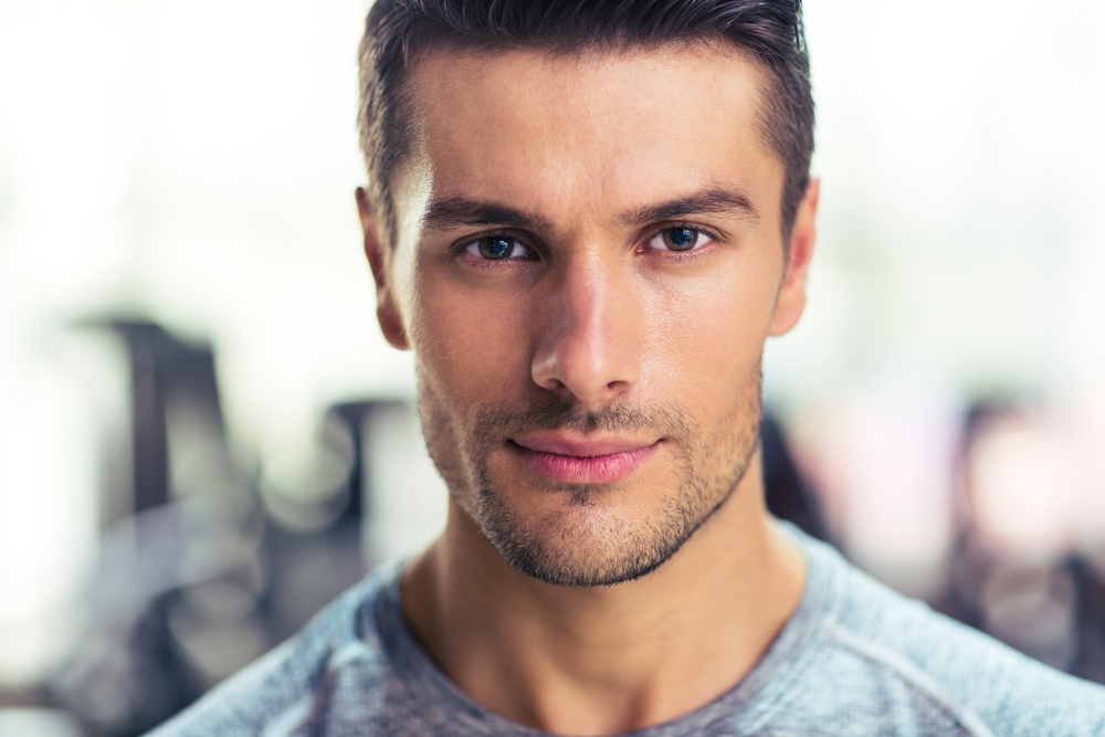 Closeup portrait of a handsome man at gym height lengthening.jpeg