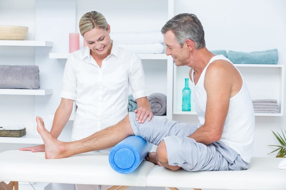 Doctor examining her patient leg in medical office stem cell therapy candidate.jpeg