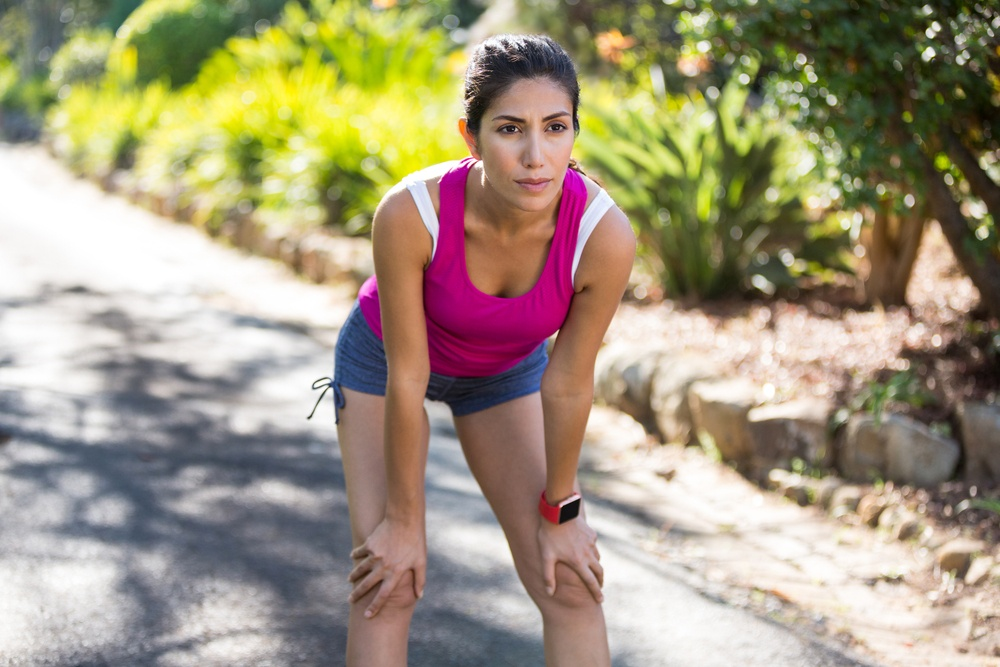 Woman exercising in a forest in the countryside.jpeg