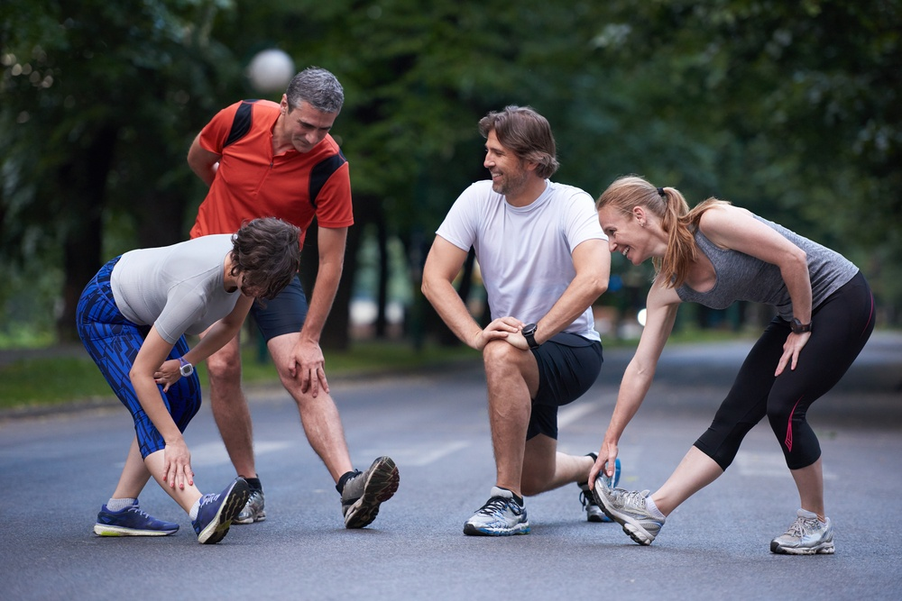jogging people group stretching in park stem cell therapy orthopedic.jpeg