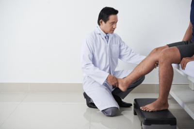 doctor examining legs