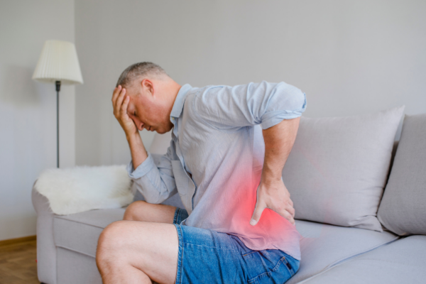 man at home with back pain