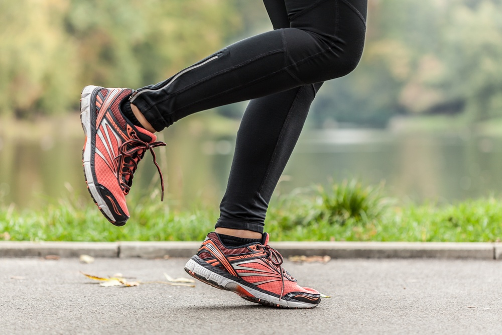 Close-up of young running in park woman's feet .jpeg